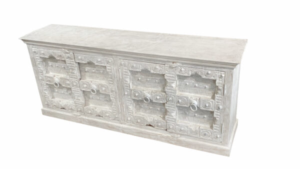 White carved sideboard cabinet with intricate door design top view