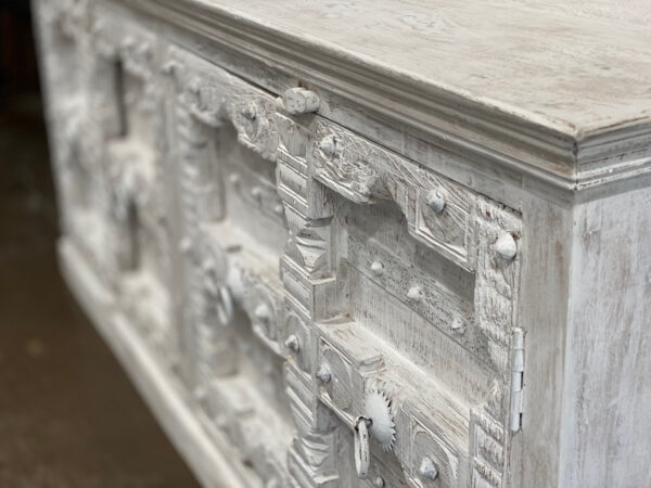 White carved sideboard cabinet with intricate door design close view