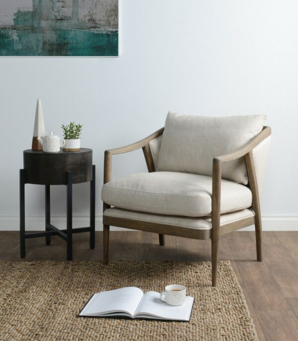 off white upholstered chair with wood frame in living room setting