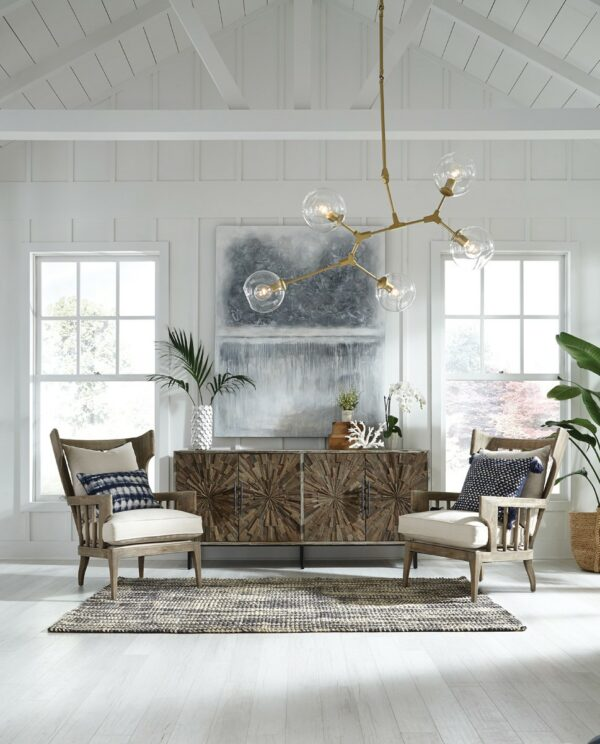 upholstered linen chair with wood frame in living room setting