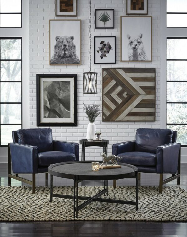 dark blue leather accent chairs on living room space