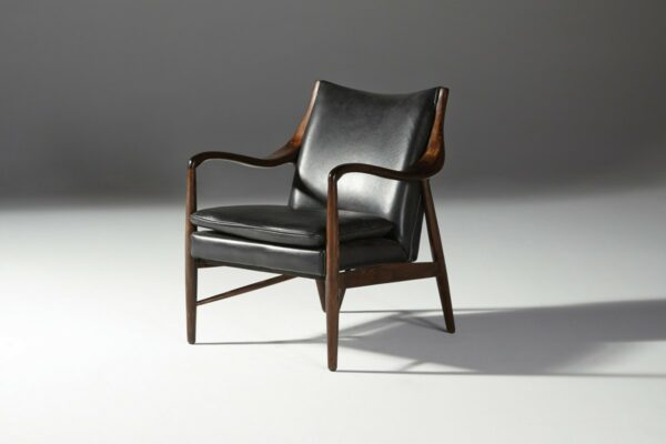 black leather chair with wood frame side view