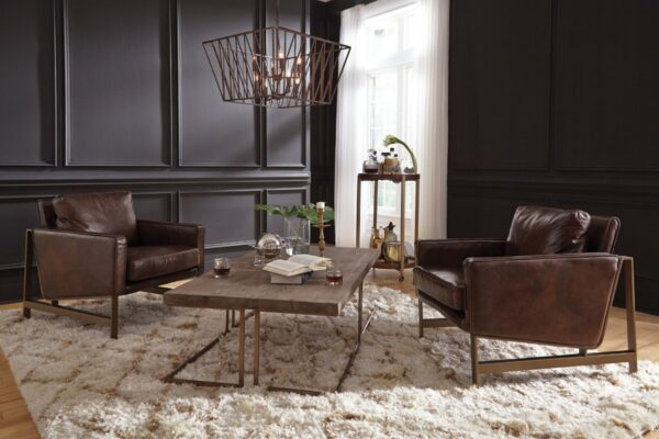 brown leather accent chair with bronze legs in living room setting