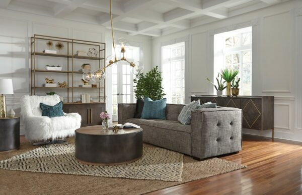 Grey fabric sofa with square arms in living room setting seen from side