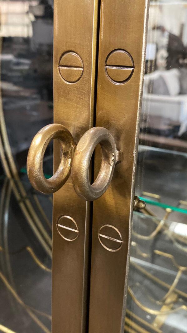 Large Porthole bar cabinet on casters front closure detail