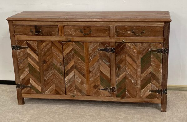 Wood cabinet with chevron design and 3 top drawers front view