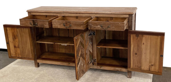 Wood cabinet with chevron design and 3 top drawers with open doors and drawers
