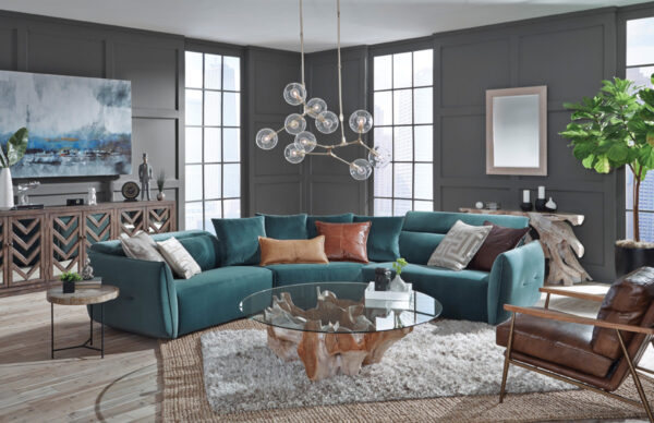 Root coffee table with round glass in living room setting