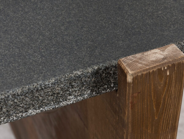 Wood console table with stone top closeup