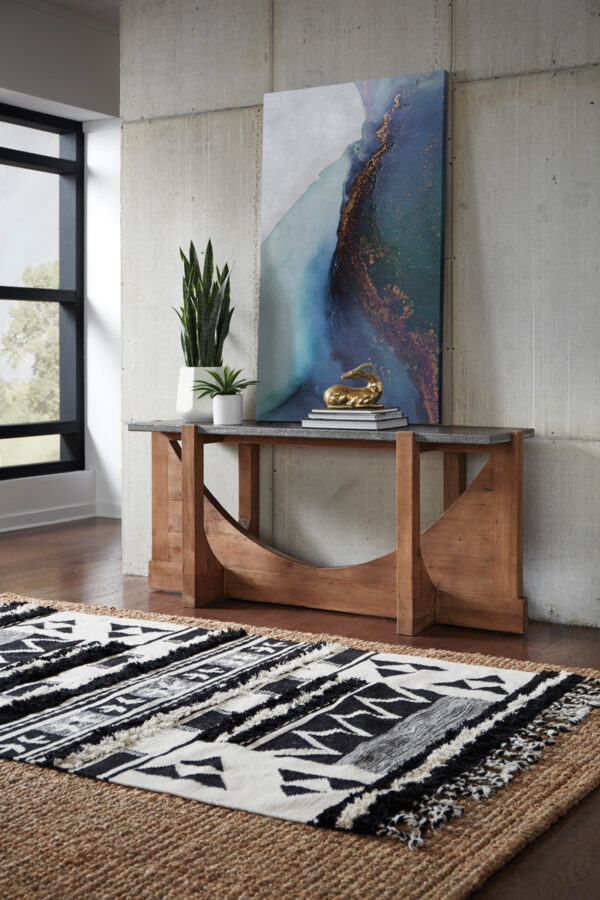 Wood console table with stone top in room setting