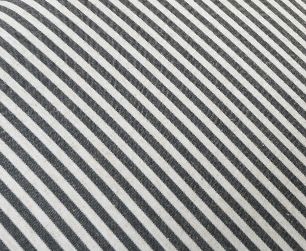 grey and white fabric close up
