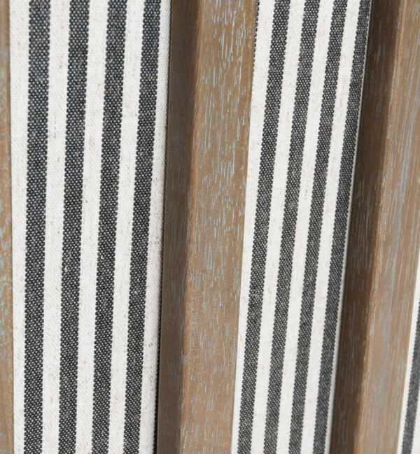 white and grey striped accent chair with wood legs close up