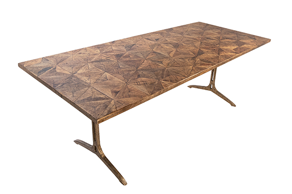 Dining table with iron base in brass finish