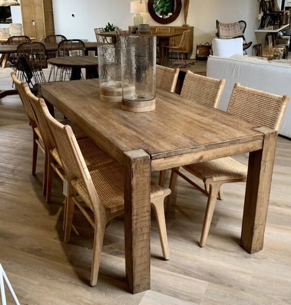 Reclaimed wood pine dining table with straight legs with rattan dining chairs