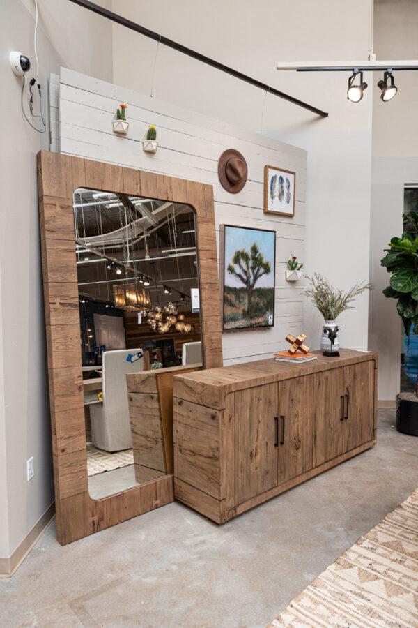tall reclaimed wood frame floor mirror in living room setting