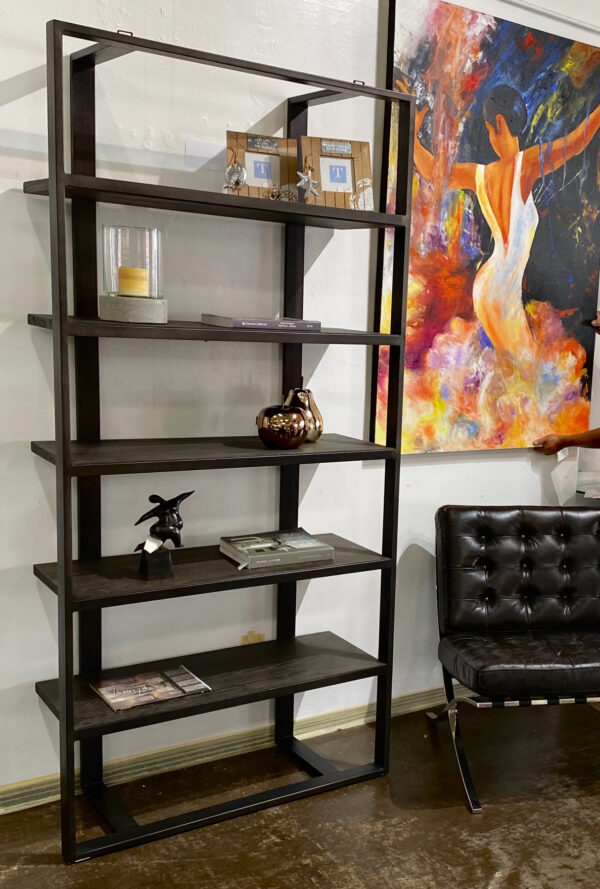 wood and iron bookcase in setting
