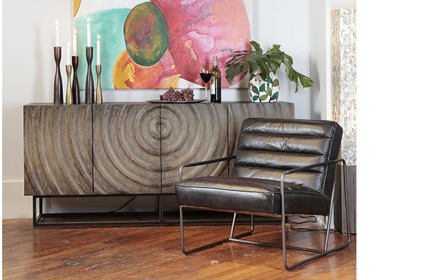 Oak sideboard with iron base showed with leather chair