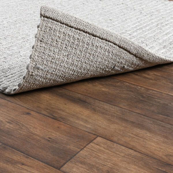 light grey woven rug