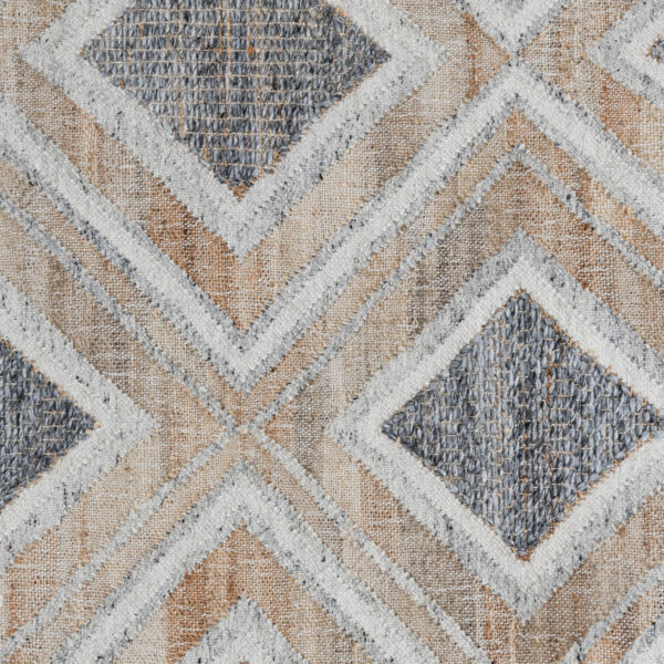 geometric design blue and ivory rug close up