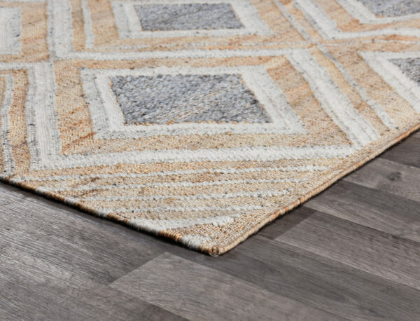 geometric design blue and ivory rug on wood floor
