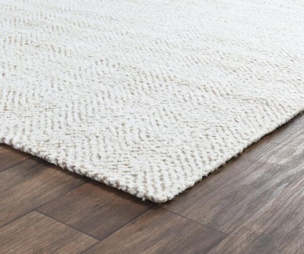 herringbone ivory jute rug on wood floor