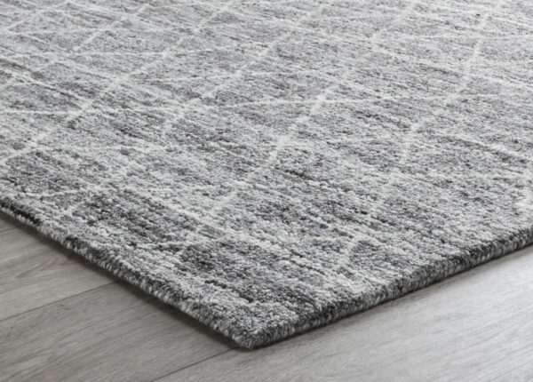gray diamond pattern wool rug on wood floor