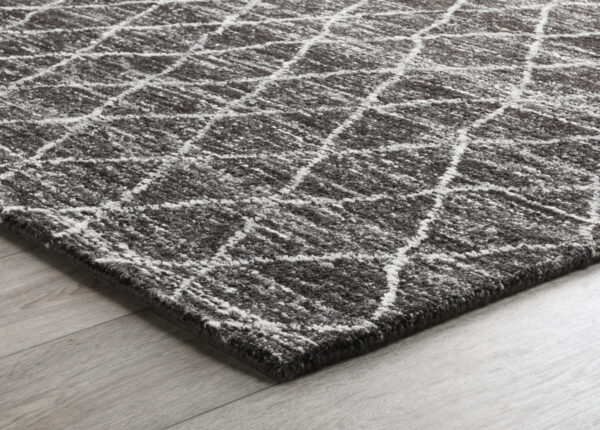 black diamond pattern wool rug on wood floor