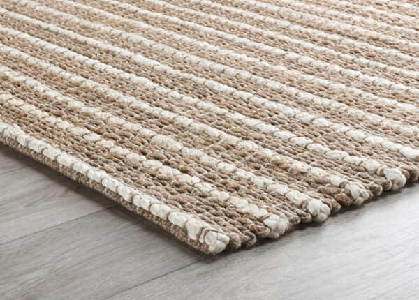 natural jute rug with ivory stripes on wood floor