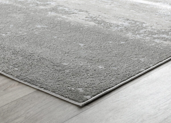 birch and silver abstract rug on wood floor