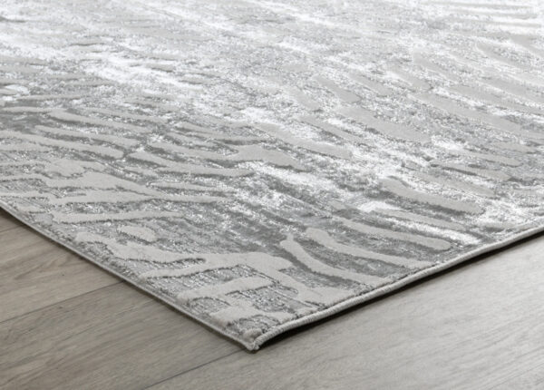 silver and birch rug with patterns close up on floor