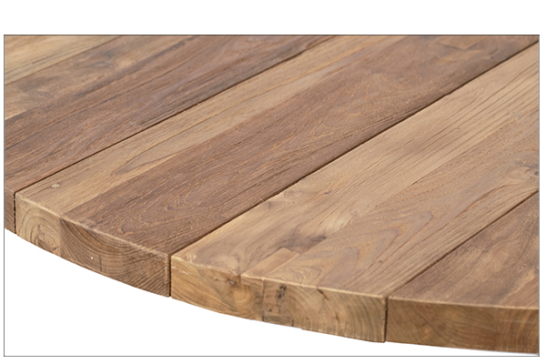 round natural wood dining table close up