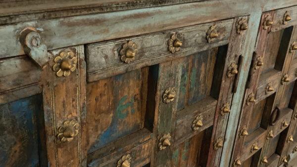 distressed turquoise teak sideboard close up