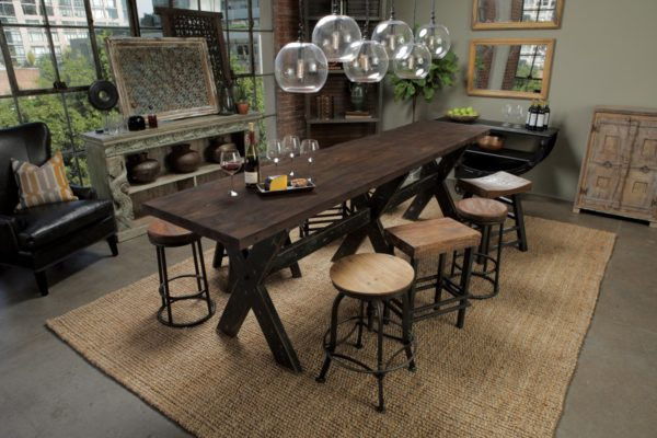 Reclaimed wood gathering table with black legs in dining room setting