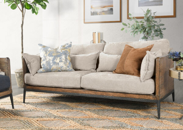reclaimed wood and ivory upholstered sofa in living room setting