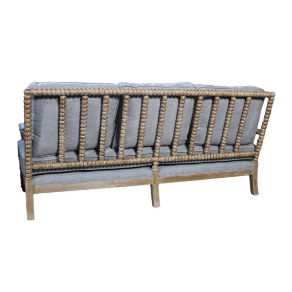 grey upholstered sofa with wood frame back view