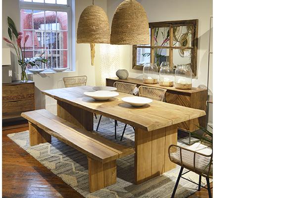 long teak bench in dining room setting