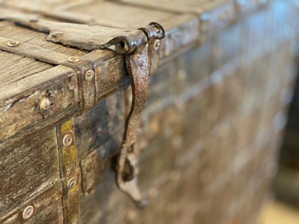 Tall Indian trunk console with iron closeup