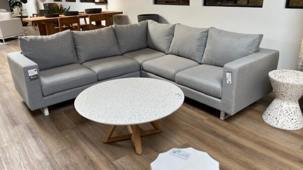 Aluminum and grey cushions outdoor sectional shown with round coffee table