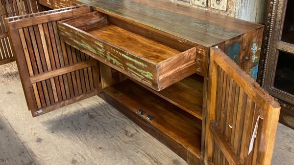 Large colorful sideboard media console with slatted doors open drawer