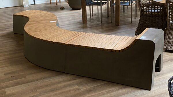 Concrete and teak curvy bench