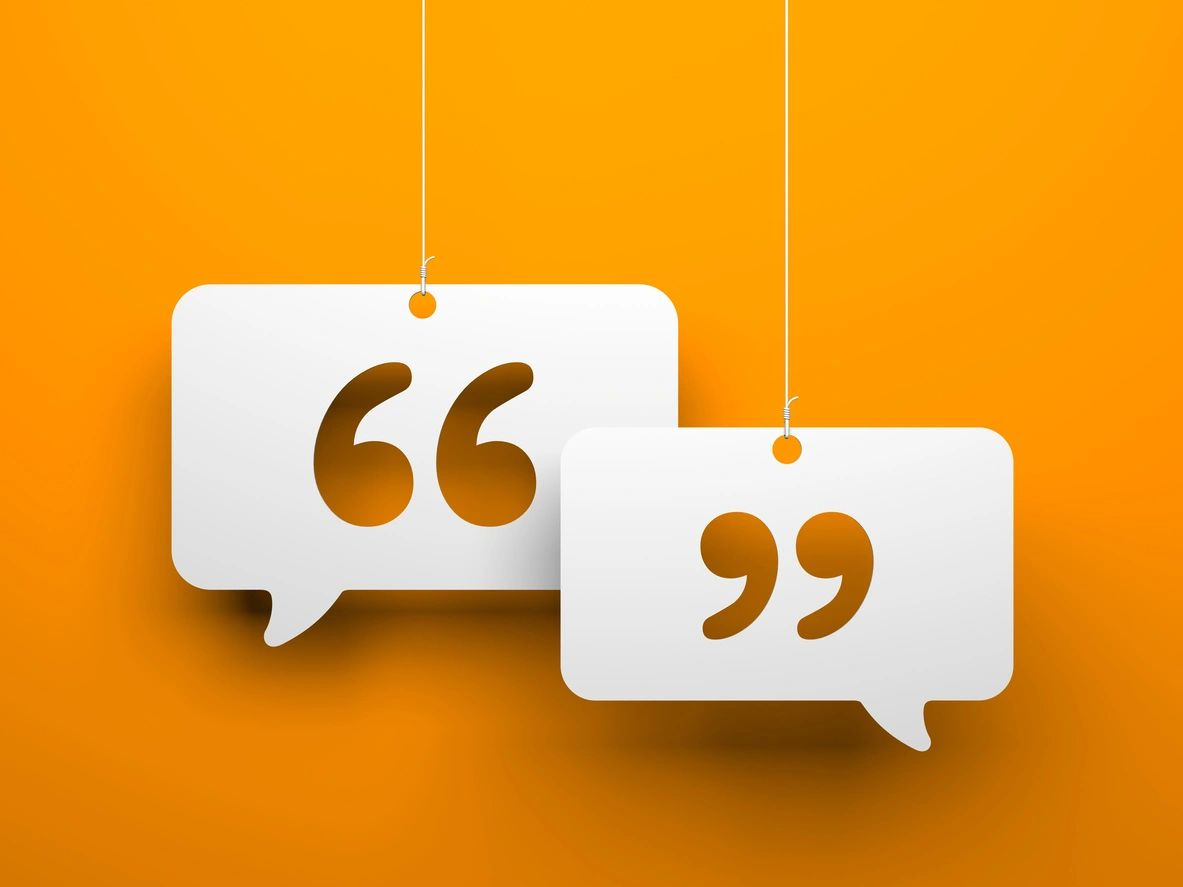 stylistic quotation marks on orange background