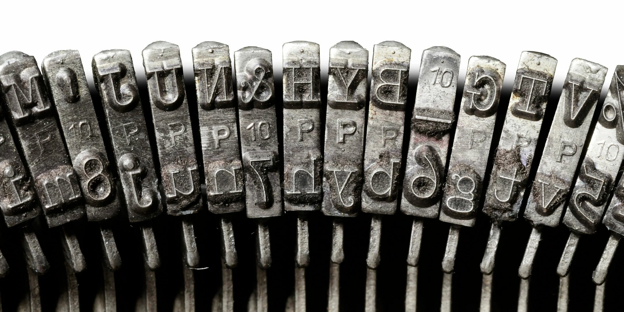 image of keys on an old-fashioned keyboard