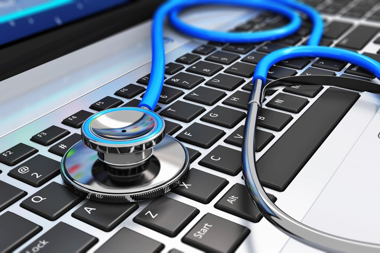 image of stethoscope resting on a computer keyboard