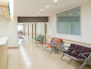 Empty seats and hallway near a hospital nurse's station