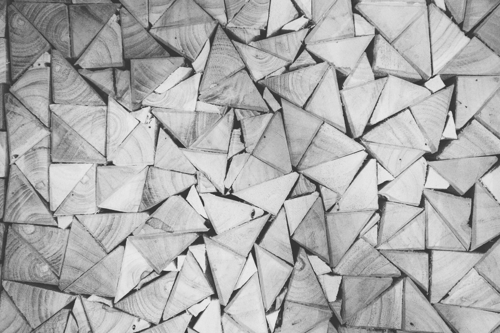 abstract, black and white photo of what may be triangles of wood