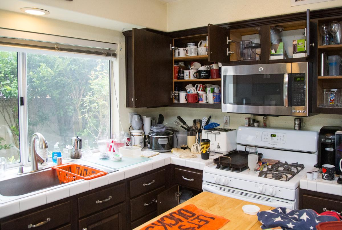 """A view of kitchen cabinets and counter space before being decluttered by professional organizer Kirsten Ranger of Organized & Orderly at a private residence in Trabuco Canyon on Tuesday. ////ADDITIONAL INFORMATION: lansner.declutter - 7/7/15 - JOSH BARBER, - ORANGE COUNTY REGISTER - at on Tuesday, July 7, 2015 in Trabuco Canyon, Calif. Columnist Jon Lansner will have a room in his home """"decluttered"""" by decluttering expert Kirsten Ranger of Organized & Orderly of Organized & Orderly"""
