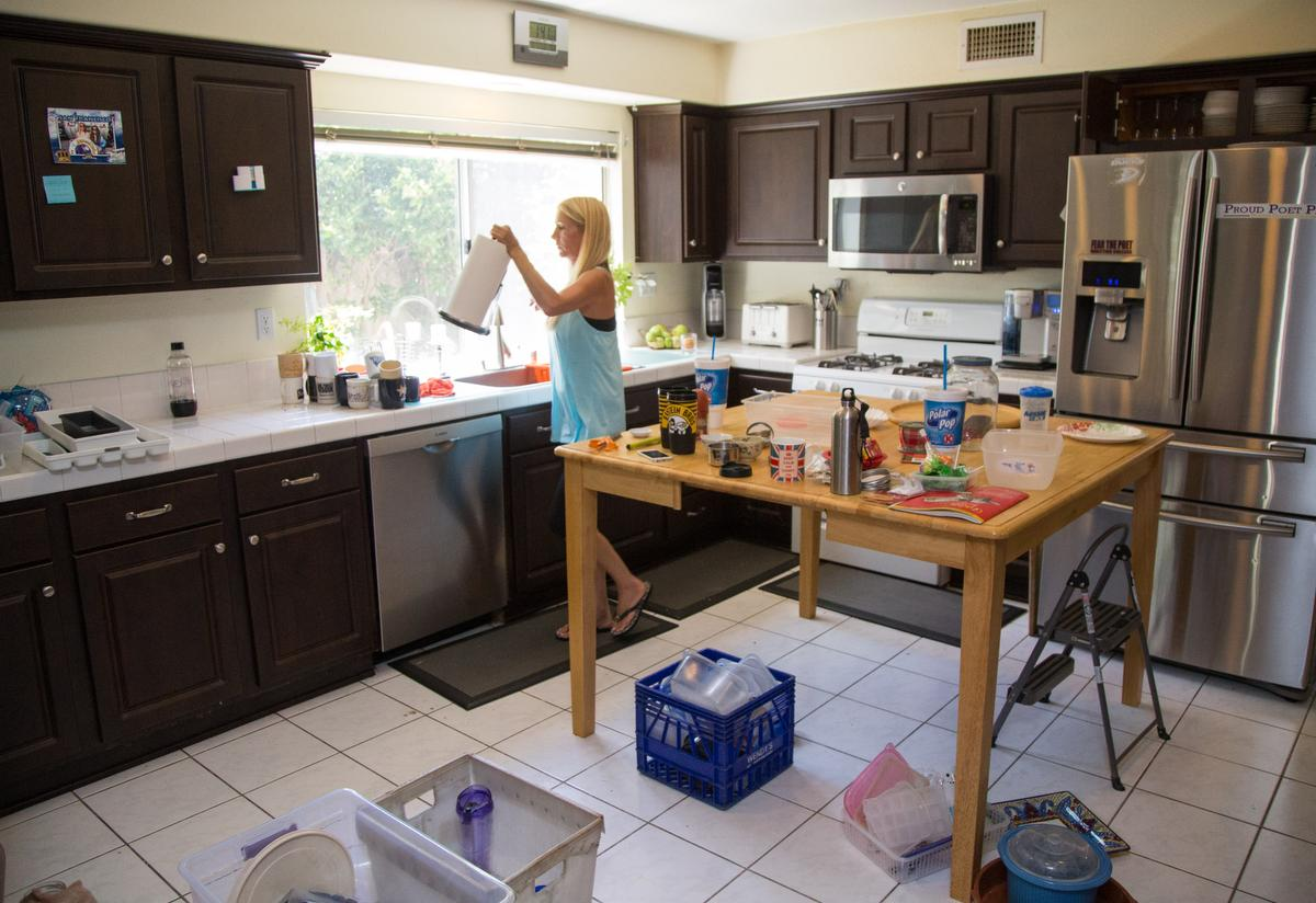 """Professional organizer Kirsten Ranger of Organized & Orderly adjusts a counter top as she begins to finish up decluttering a kitchen at a private residence in Trabuco Canyon on Tuesday. ////ADDITIONAL INFORMATION: lansner.declutter - 7/7/15 - JOSH BARBER, - ORANGE COUNTY REGISTER - at on Tuesday, July 7, 2015 in Trabuco Canyon, Calif. Columnist Jon Lansner will have a room in his home """"decluttered"""" by decluttering expert Kirsten Ranger of Organized & Orderly of Organized & Orderly"""
