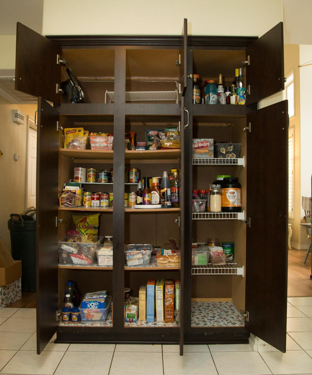 """A view of a kitchen pantry after being decluttered by professional organizer Kirsten Ranger of Organized & Orderly at a private residence in Trabuco Canyon on Tuesday. ////ADDITIONAL INFORMATION: lansner.declutter - 7/7/15 - JOSH BARBER, - ORANGE COUNTY REGISTER - at on Tuesday, July 7, 2015 in Trabuco Canyon, Calif. Columnist Jon Lansner will have a room in his home """"decluttered"""" by decluttering expert Kirsten Ranger of Organized & Orderly of Organized & Orderly"""