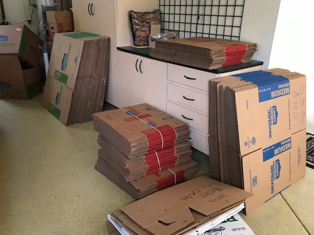 folded boxes ready for move