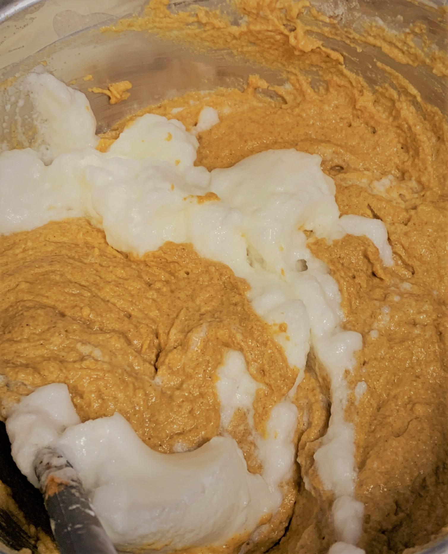 Folding the Whipped Egg Whites into our Pumpkin Mickey Waffles Batter